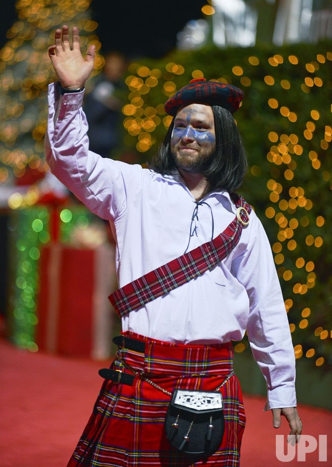 Floats, movie characters and marching bands at the 85th Hollywood Christmas Parade