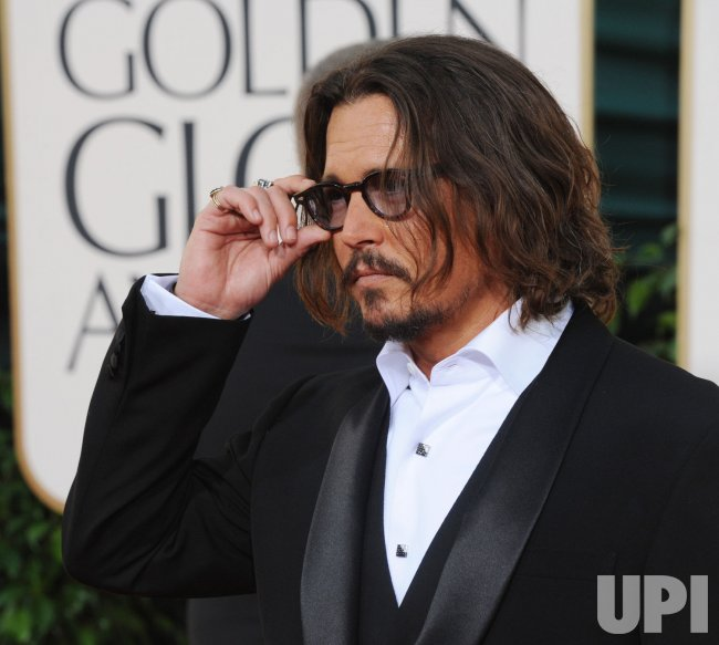 Johnny Depp arrives at the 68th annual Golden Globe Awards in Beverly Hills, California