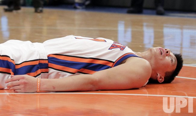 New York Knicks Jeremy Lin lies on the court at Madison Square Garden in New York