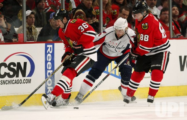 Blackhawks Bolland and Kane an Capitals Fleischman skate in Chicago