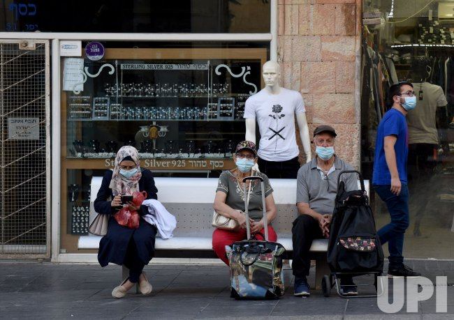 Israelis Wear Protective Masks in Jerusalem