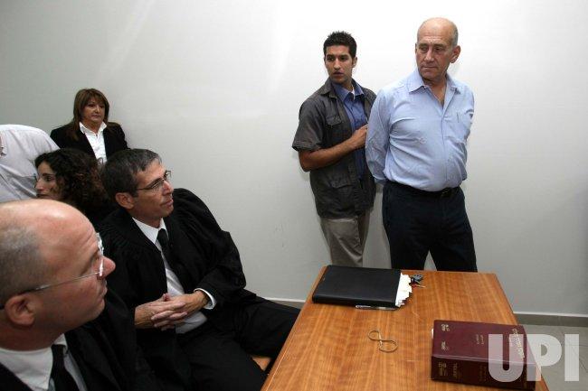 Former Israeli Prime Minister Olmert begins corruption trial in Jerusalem