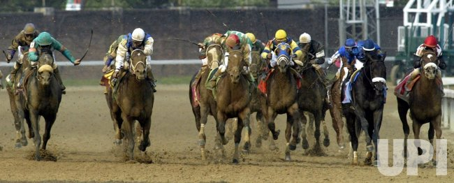Jockey Mike Smith and Giacomo leads the pack to the finish line in the Kentucky Derby