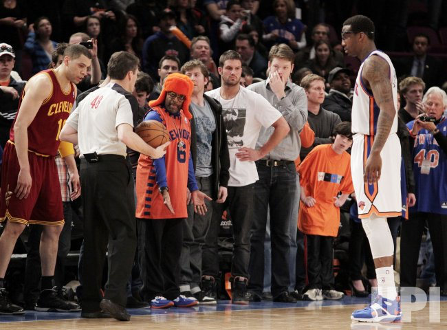 Director Spike Lee reacts next to official Scott Foster as New York Knicks Amar'e Stoudemire at Madison Square Garden in New York
