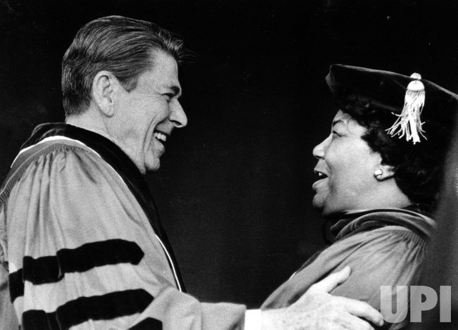 President Ronald Reagan embraces singer Pearl Bailey on the commencement platform at Seton Hall University.