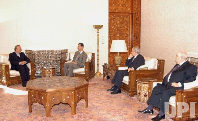 Iran's Foreign Minister Manouchehr Mottaki Meets Syrian President Bashar Assad in Damascus