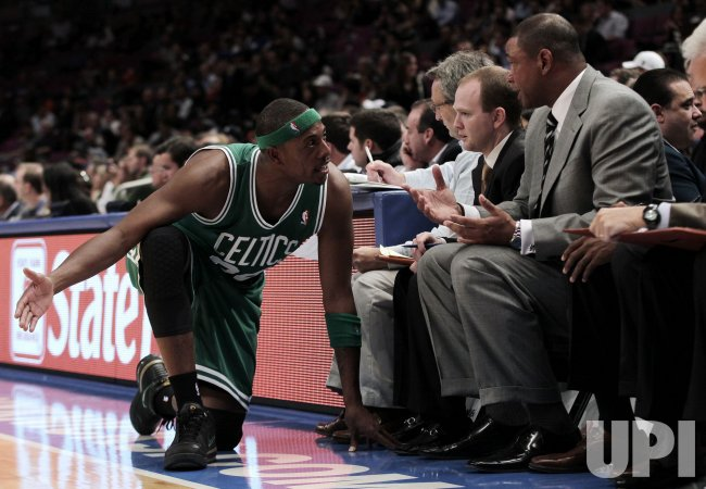 Boston Celtics Paul Pierce talks to head coach Doc Rivers at Madison Square Garden in New York