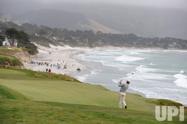 Graeme McDowell hits on the 9th fairway during the U.S. Open in Pebble Beach, California