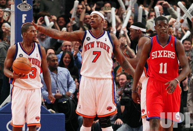 New York Knicks Toney Douglas (23), Al Harrington and Philadelphia 76ers Jrue Holiday (11) react at Madison Square Garden
