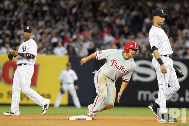New York Yankees Robinson Cano and Derek Jeter react as Philadelphia Phillies Shane Victorino steals second base at Yankee Stadium in New York