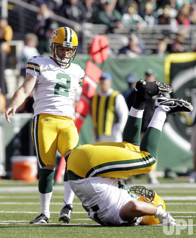 Green Bay Packers kicker Mason Crosby and Daryn Colledge react at New Meadowlands Stadium in New Jersey