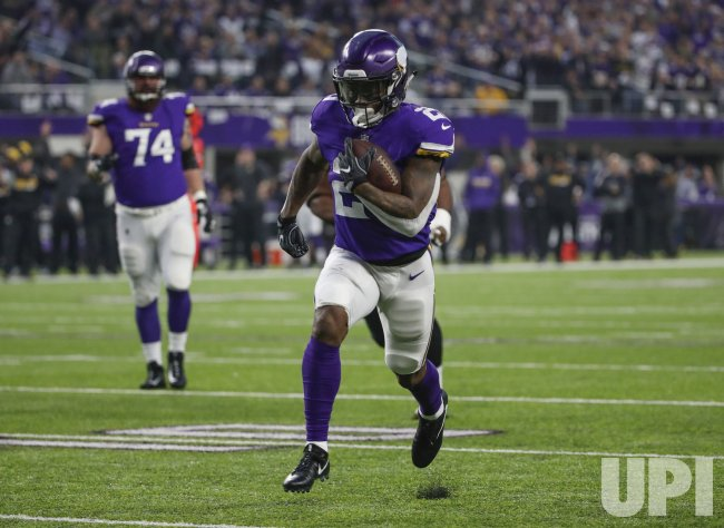 Vikings running back Jerick McKinnon rushes for a touchdown against the Saints in the NFC Divisional playoff game