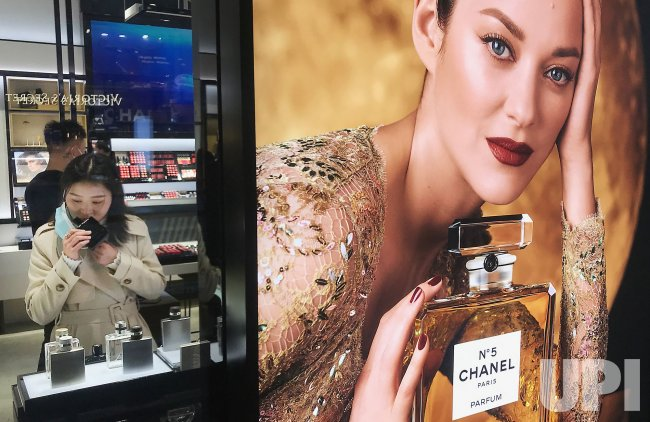 Chinese Woman Explores Perfumes at a Fashion Mall in Beijing, China