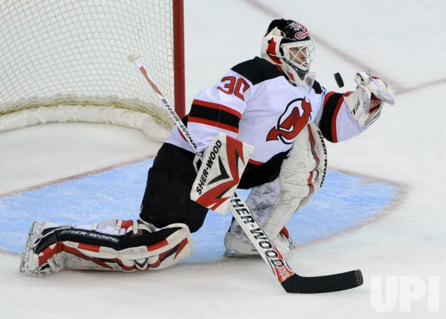 Devils goalies Brodeur catches shot from the Capitals in Washington