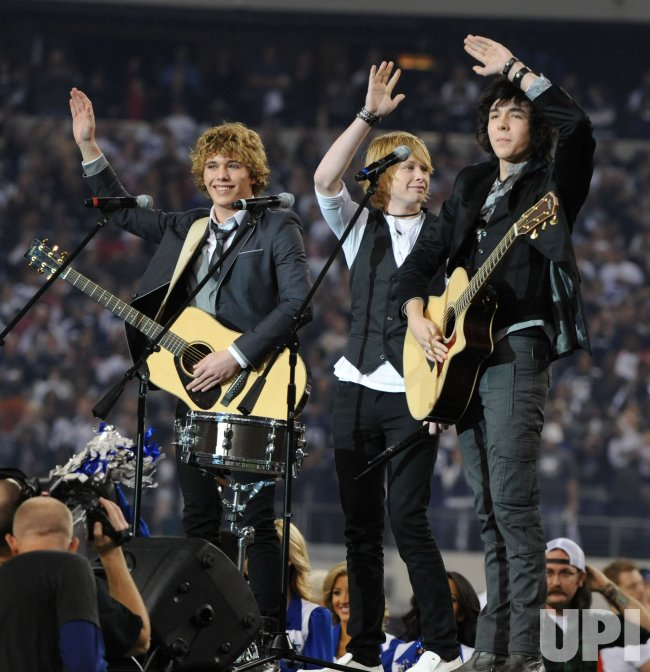 New Hollow performs the National Anthem prior to the Cowboys Saints game