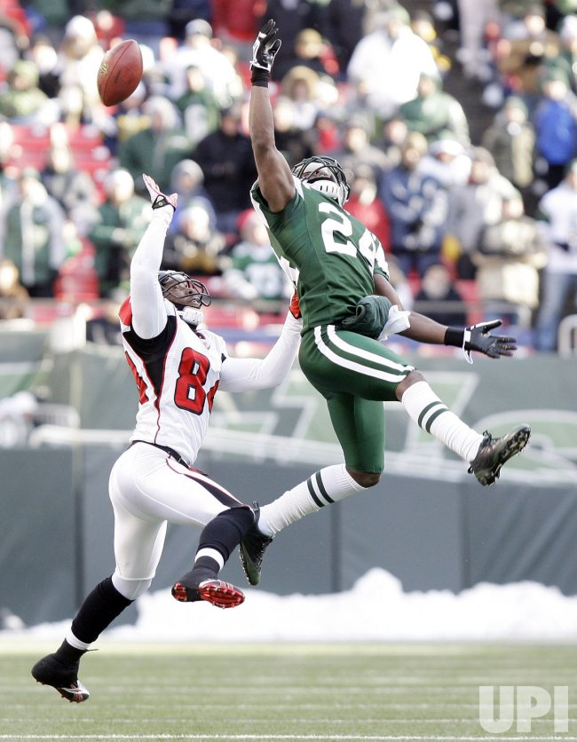 New York Jets Darrelle Revis breaks up a pass intended for Atlanta Falcons Roddy White at Giants Stadium in New York