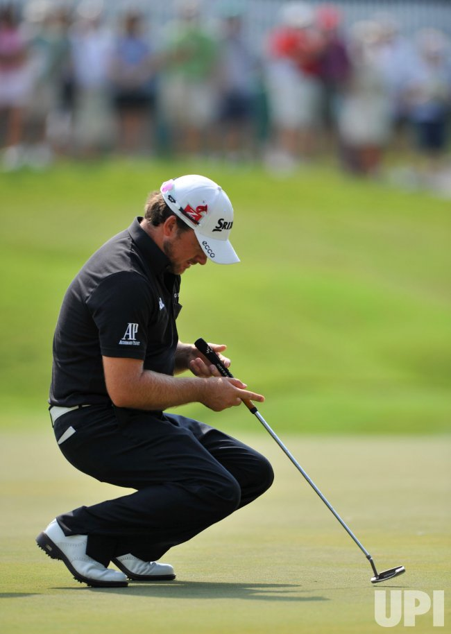 Graeme McDowell collapses after missing birdie putt during the TPC Players in Florida