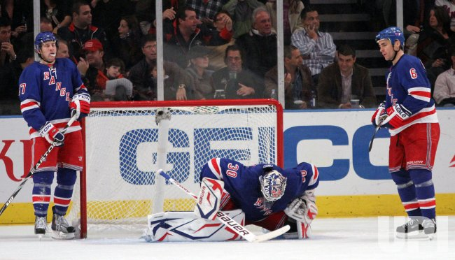 New York Rangers Donald Brashear, Henrik Lundqvist and Wade Redden react after Florida Panthers Steve Reinprecht scores a goal in the second period at Madison Square Garden in New York
