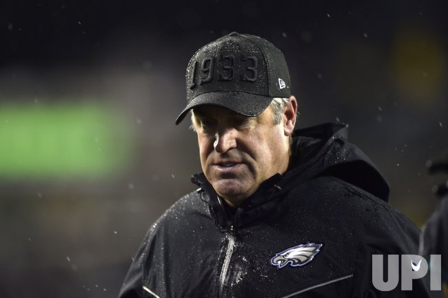 Eagles head coach Doug Pederson walks off the field