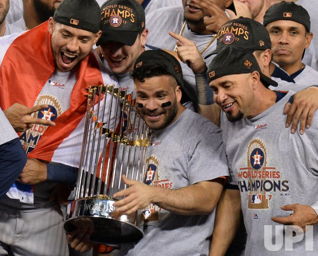 Astros Altuve holds Commissioners Trophy in the World Series