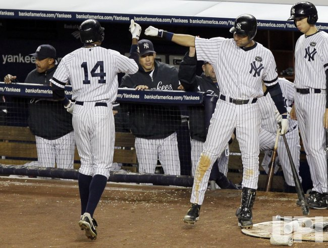 New York Yankees Derek Jeter congratulates Curtis Granderson in Game 5 of the 2010 ALCS at Yankee Stadium in New York
