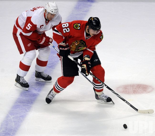 Blackhawks Kopecky and Red Wings Lindstrom in Chicago
