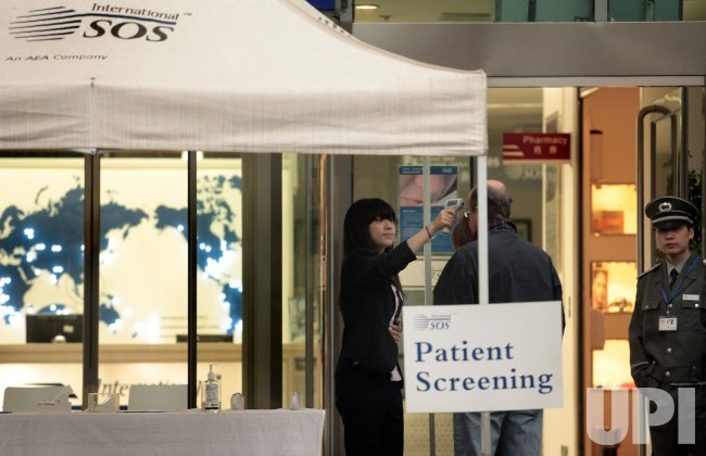 Chinese nurse check temperature of patients in Beijing.