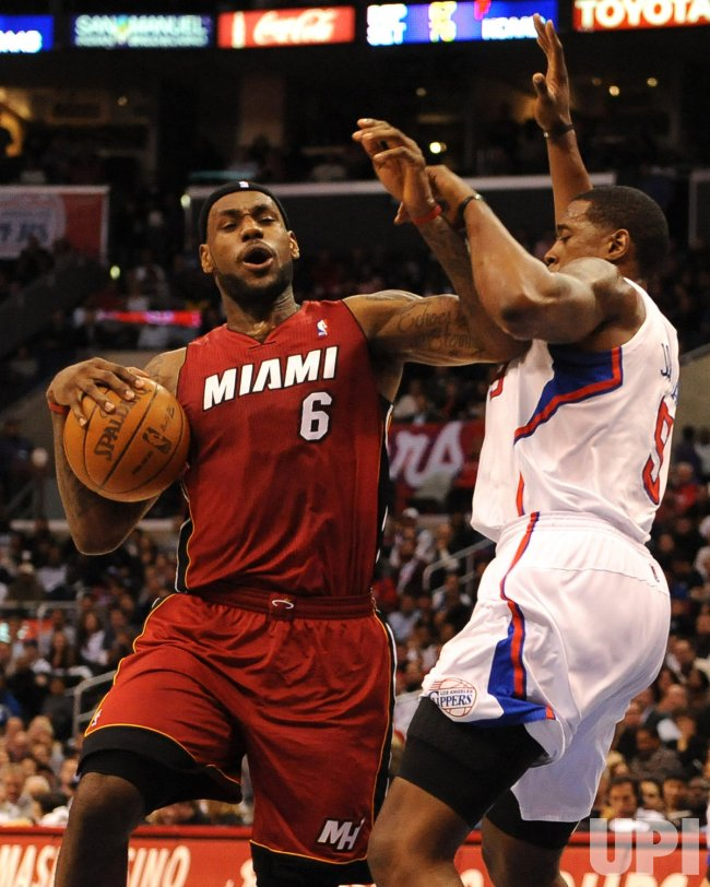 LeBron James is fouled by DeAndre Jordan