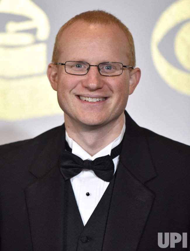 Keith Hancock wins an award at the 59th annual Grammy Awards in Los Angeles