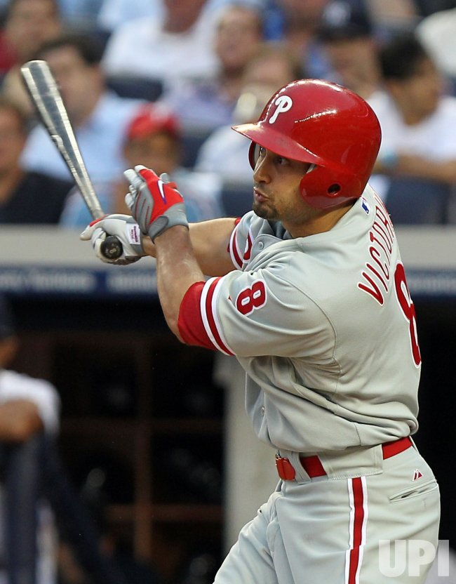 Philadelphia Phillies Shane Victorino drives in 3 runs with a triple at Yankee Stadium in New York