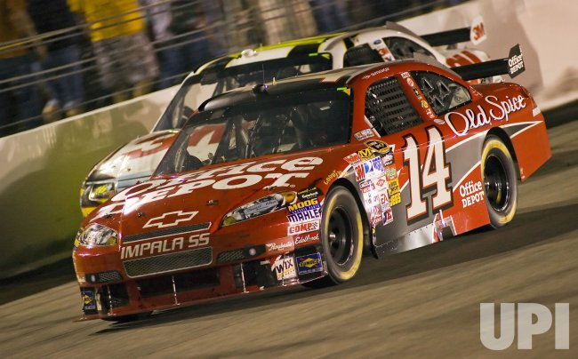 Tony Stewart passes Greg Biffle during the running of the NASCAR Chevy Rock & Role 400 at Richmond International Raceway in Richmond, Virginia