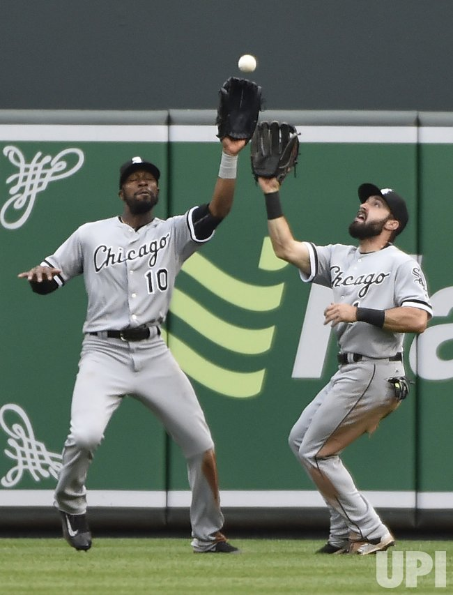 White Sox outfielders Austin Jackson (10) and Adam Eaton get crossed up on the final Baltimore out