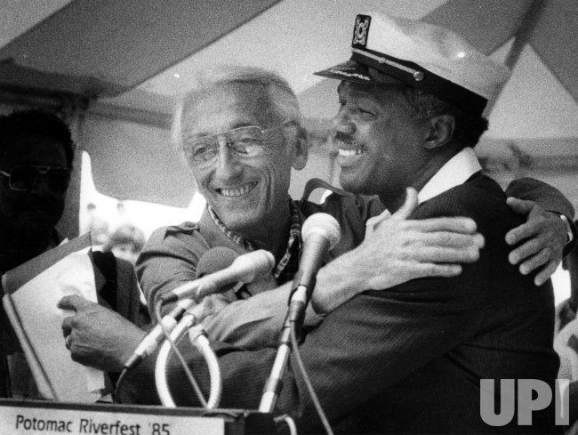 Mayor Marion Barry of the District of Columbia has a welcoming hug for Jacques Cousteau.