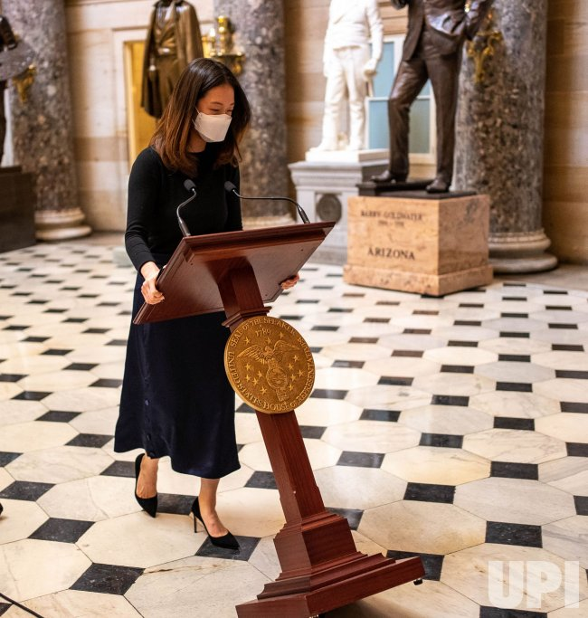 Peolsi's Podium Wheeled through Statutory Hall