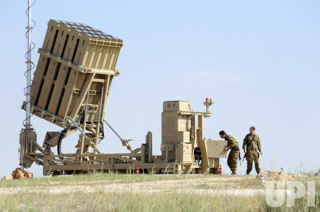 Israeli soldiers work on the new Israeli anti-rocket system, the Iron Dome, in southern Israel
