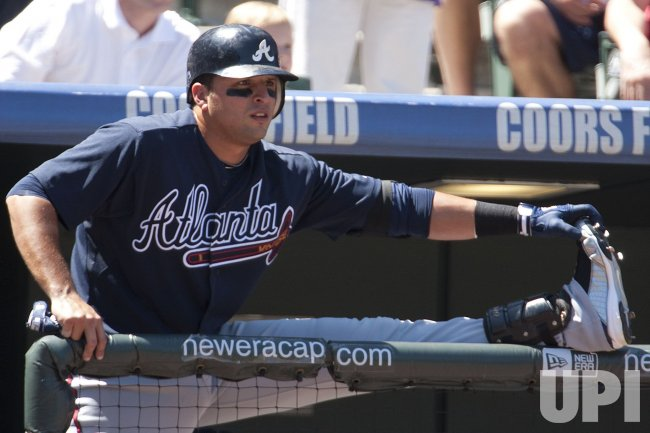 Braves Prado Stretches Before Batting in Denver