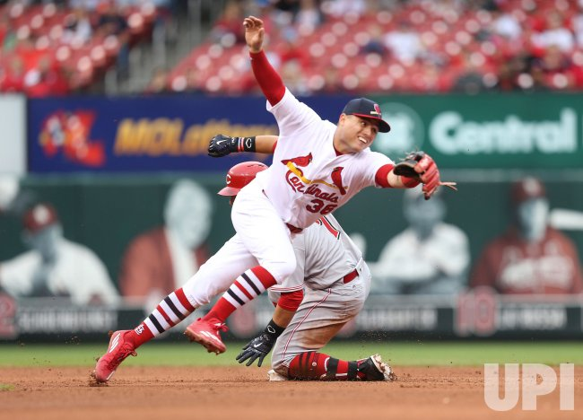 St. Louis Cardinals Aledmys Diaz can't get to wide throw from Molina