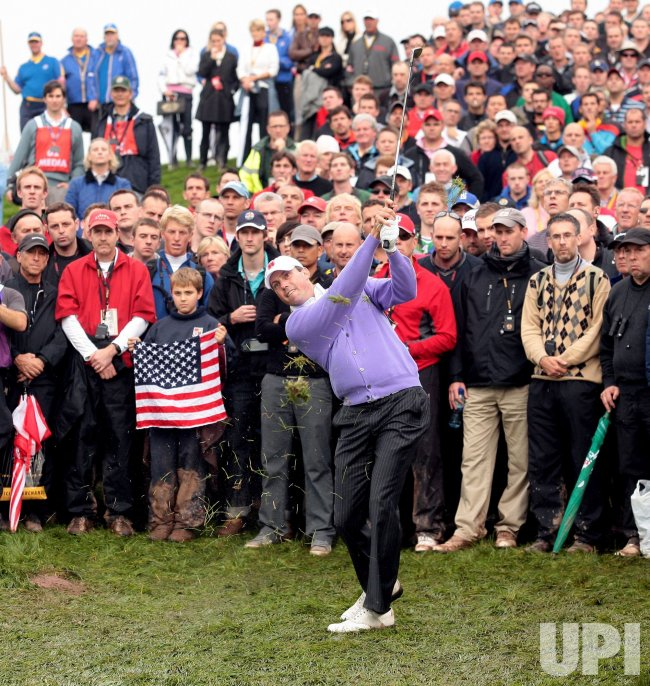 Kuchar hits out of the rough on the second day of Ryder Cup.