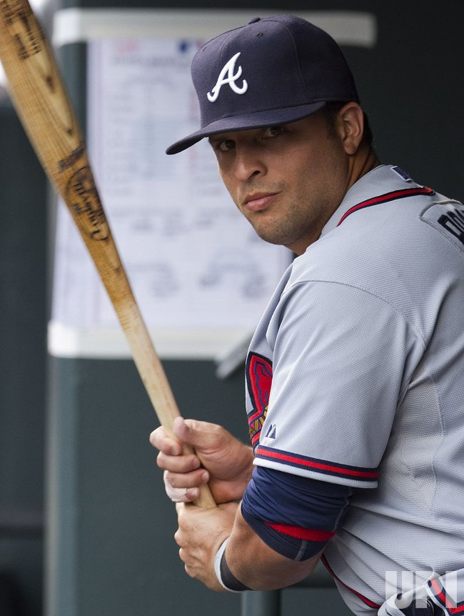 Braves Prado Prepares to Bat Against the Rockies in Denver