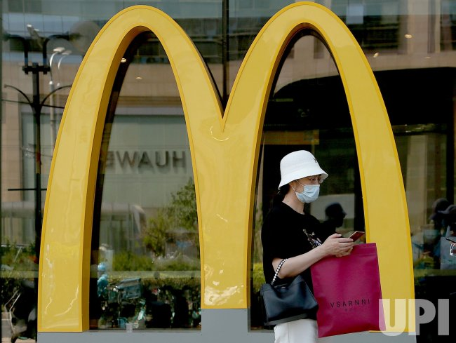 Chinese Woman Stands Outside McDonald's in Beijing, China