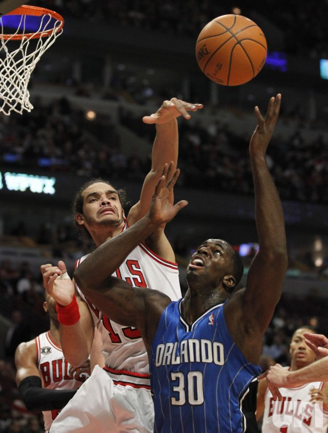 Bulls Noah and Magic Bass go for rebound in Chicago