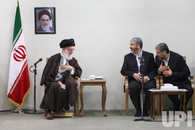Iranian supreme leader Ayatollah Ali Khamenei meets with Hamas leader Mashaal in Iran