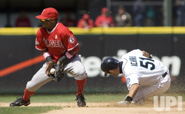 Seattle Mariners' Ichiro Suzuki (R) steals second base as Los Angeles Angels shortstop Erick Aybar waits for the throw.