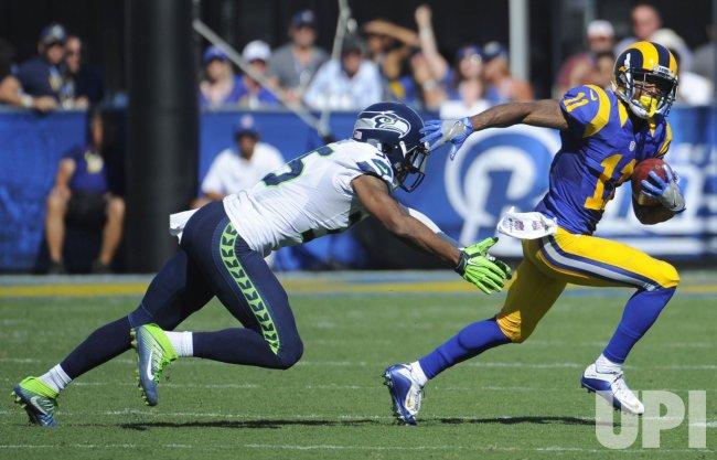 Los Angeles Rams Kenny Britt gets away from Seattle Seahawks DeShawn Shead