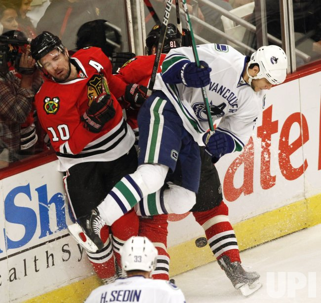 Blackhawks Sharp and Canucks Bieksa collide in Chicago