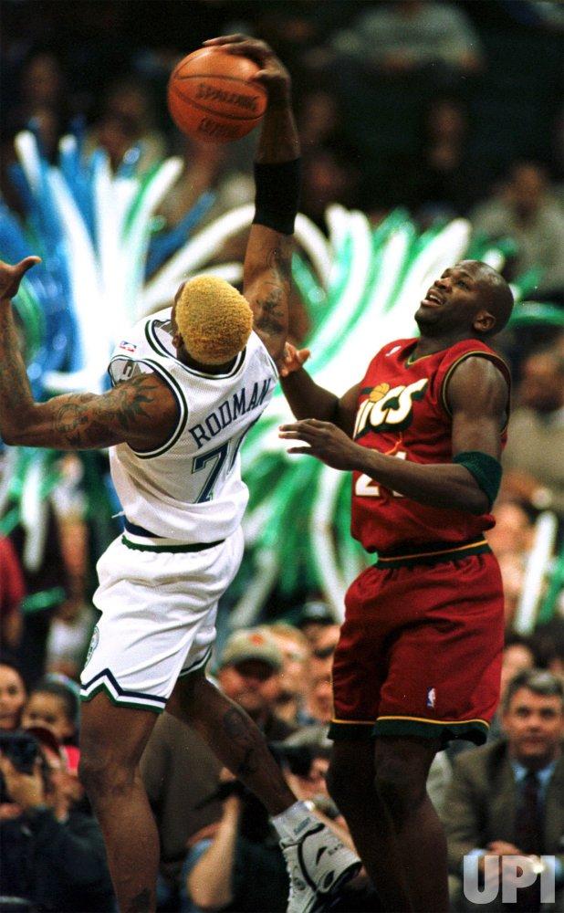 Rodman plays with Mavericks