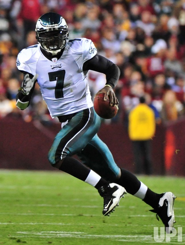 Eagles quarterback Michael Vick scrambles in Washington
