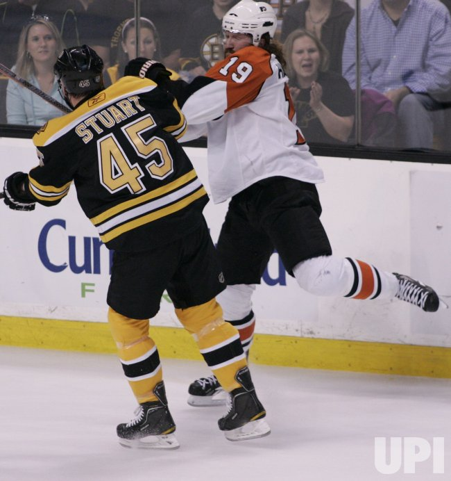 Bruins Stuart hits Flyers Hartnell in Game 7 of the NHL Eastern Conference Semi-Final in Boston, MA.