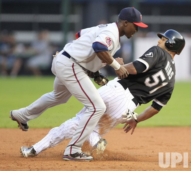 Twins Hudson tags out White Sox Rios in Chicago