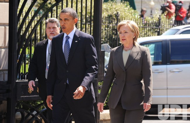President Obama walks with Secretary of State Clinton to the